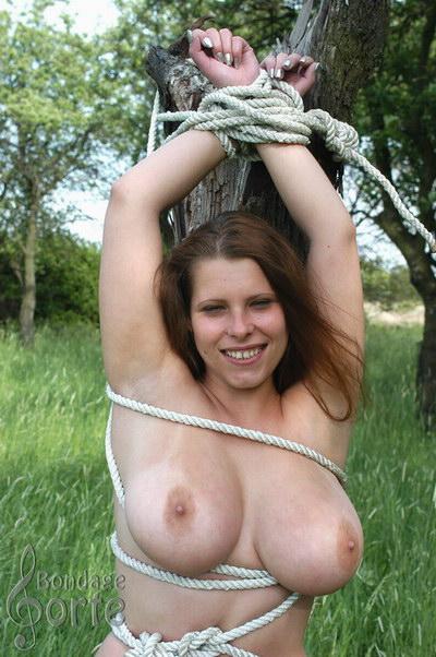 Women strung up naked all
